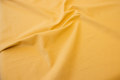 Yellow, ruggedly woven opholstry-fabric in linen-cotton