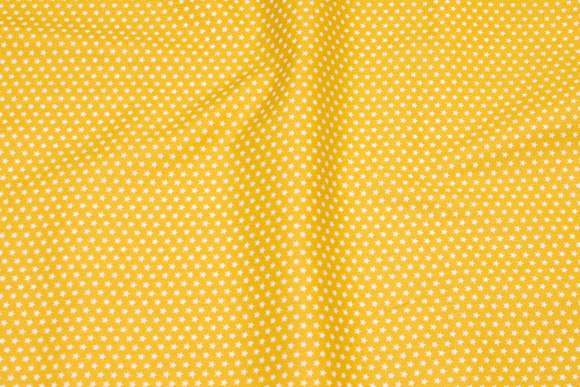 Brass-yellow, firm cotton with white mini stars