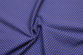 Cotton-poplin with dots in blue and dirt-brown .