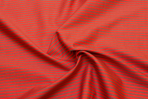 Cotton-poplin with narrow stripes in orange and dirt-brown