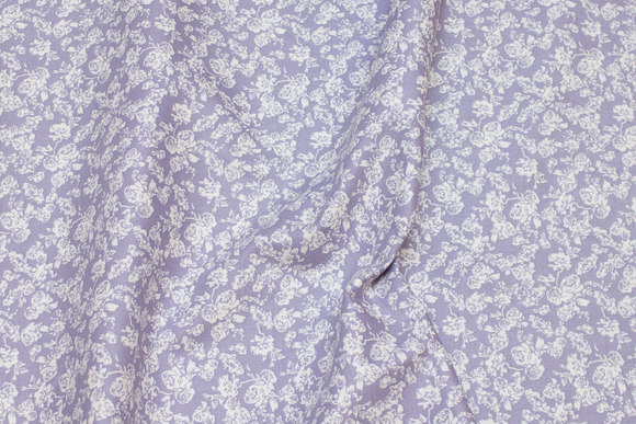 Firm cotton in light dusty-purple with small white flowers