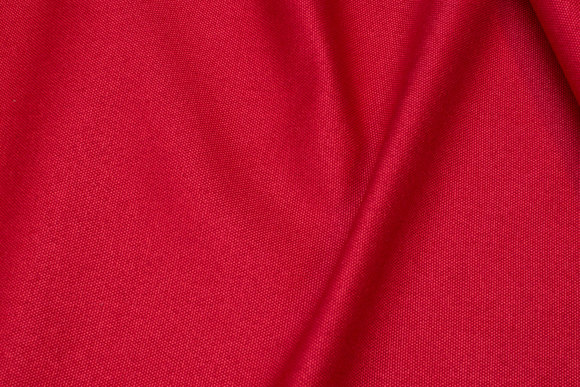 Furniture fabric in speckled red with light back