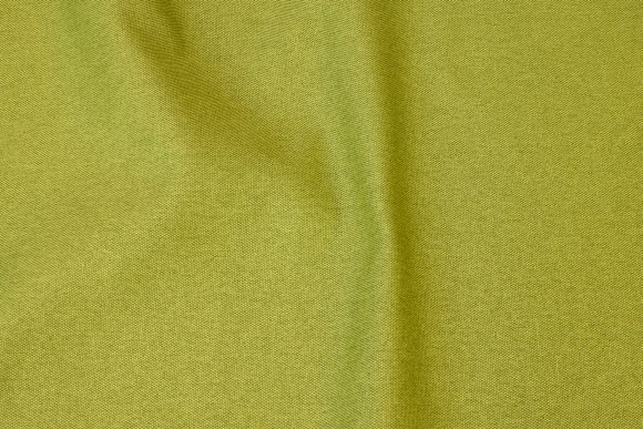 Kiwi-green speckled opholstry fabric with light back