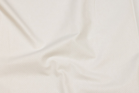 Light sand-colored firm cotton with white mini-dots