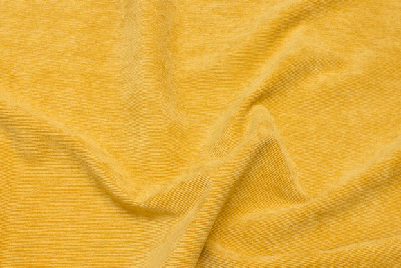 Narrow-rifled polyester-corduroy in light brass-yellow