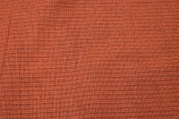 Rust-colored, ruggedly woven opholstry fabric