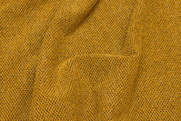 Soft, light knit in brass-yellow