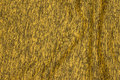 Soft speckled winter-knit in brass-yellow.