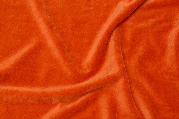 Stretch velvet in burned orange