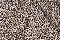 Light polyester-jersey in sand-colored with small animal-print.