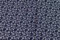 Navy patchwork-cotton with small light flowers.