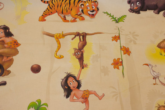Woven cotton with Jungleboook motifs