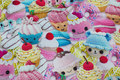 Fun cotton-jersey with knitted cupcakes in pastel-colors