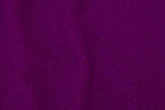 100% wool bouclé in dark fuchsia colored