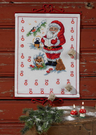 White christmas calendar with Santa claus and a fox