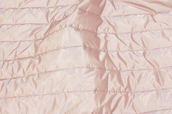 Coated quilt in delicate old rose for jackets and vests etc.