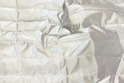 Coated quilt in silver-colored for jackets and vests etc.