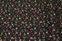 Firm, black small-dotted cotton with small pink roses