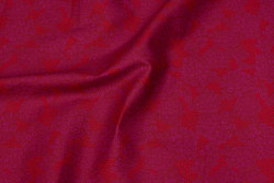 Firm, cherry-red cotton with discrete pattern