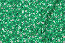 Firm, grass green cotton with light flowers