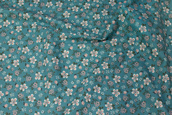 Firm, petrol-colored cotton with light flowers