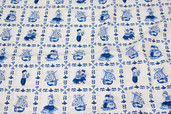 Firm, white cotton with blue sqaure-pattern with motifs