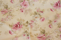 Medium-thickness off-white and soft red cotton-polyester with roses