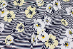 Viscose-jersey in narrow-striped navy and white with flowers