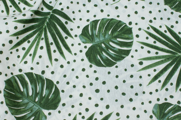 White deko-fabric with green leaves and dots
