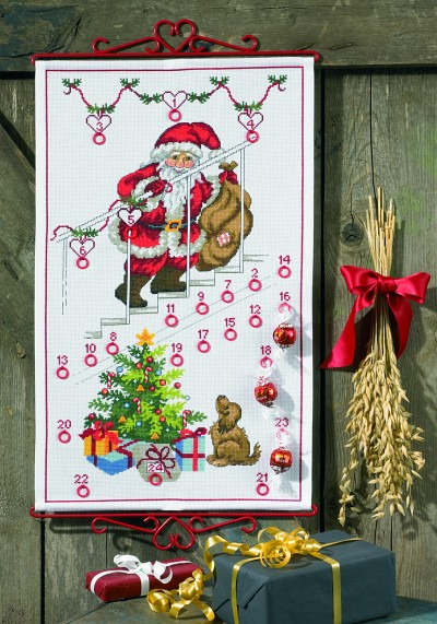 White christmas calendar with Santa on stairs