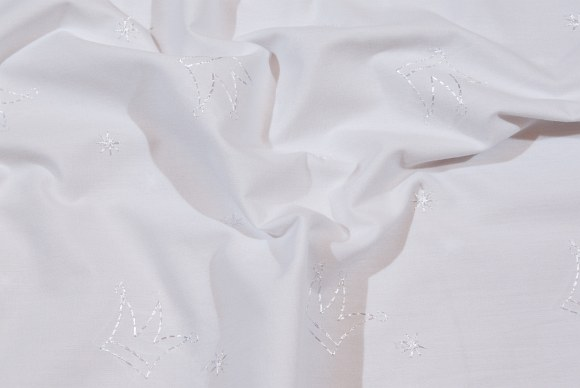 White embroidery anglaise with crowns