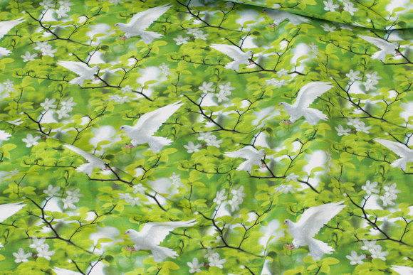Spring green cotton-jersey with white pigeons