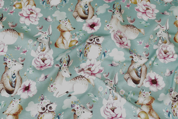 Mint-green cotton-jersey with forest-animals in pastel-colors
