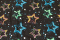 Black cotton-jersey with stars in beautiful neon-colors.