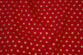 Red cotton with printed gold stars on 1 cm