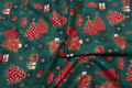 Green christmas fabric with red christmas trees