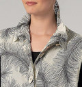 Loose-fitting, unlined vest has collar, front-buttoned band, back self-lined yoke, pleat and applied, exposed zipper, and bias armhole facings. Elastic forms ruffle for collar and button pockets. Tapered pants (loose-fitting through hips) have elasticized waist and lower side pleats. Both have stitched hems.
