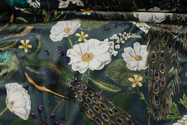 Beautiful velvet in dark blue-green with peacocks and flowers in digital-print