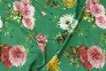 Grass green cotton-jersey with flowers.