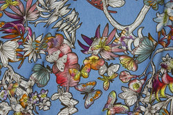 Light blue viscose jersey with flowers and butterflies