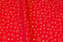 Red christmas-cotton with ca. 15 mm gold-snow-crystals