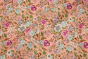Soft red cotton with small flowers in light blue and pink