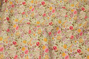 Off white cotton with small flowers in red and yellow