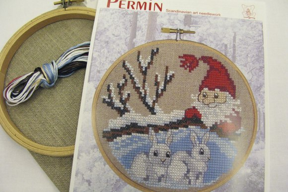 Embroidery snowy landscape and rabbits