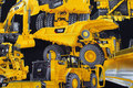 Big yellow work-machines on black base