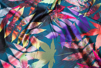 Lightweight stretch-satin in dark green with big colorful leaves