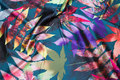 Lightweight stretch-satin in dark green with big colorful leaves.