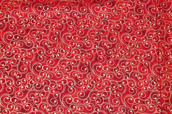 Red-speckled patchwork-cotton with gold print