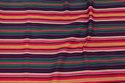 Striped along fabric length.