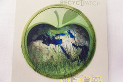 Recycled apple earth patch 6 cm diam.